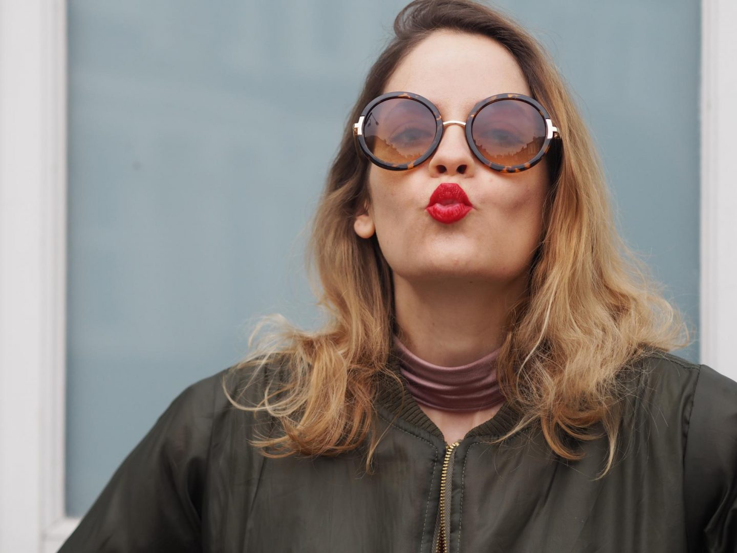 Topshop sunglasses and khaki bomber jacket from Trendeo