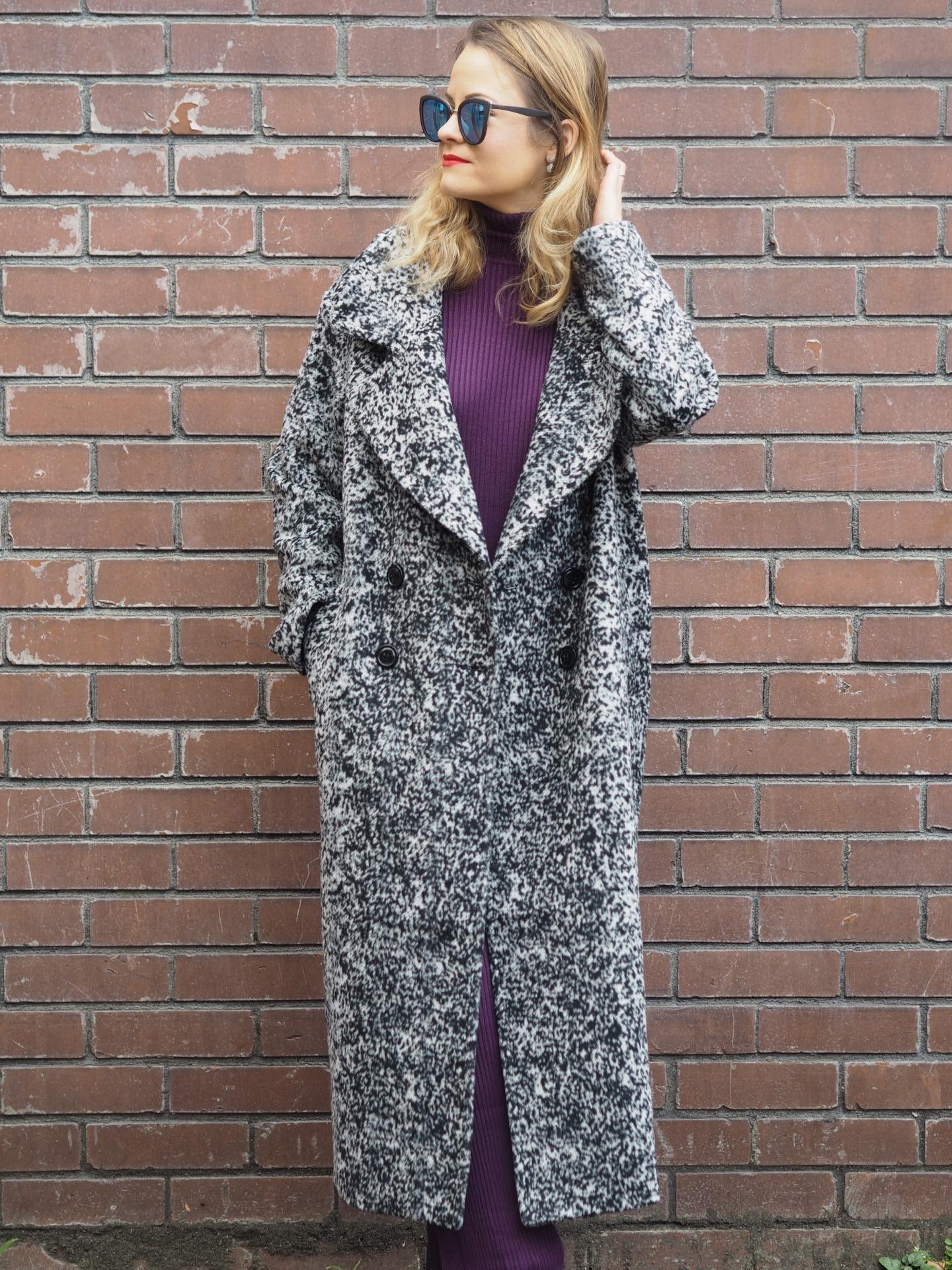 Fashion blogger against brick wall